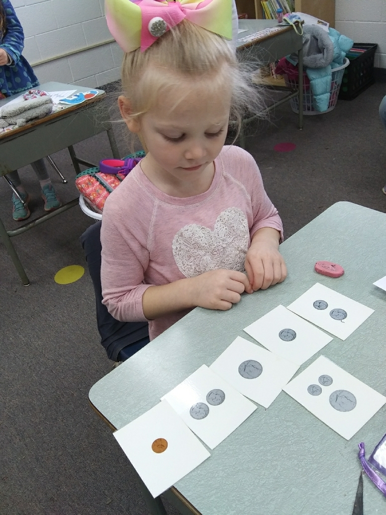 First graders are learning to count money.