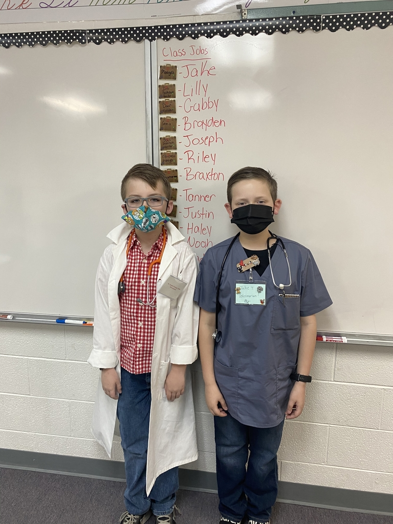 Joseph and Jake dressed as veterinarians