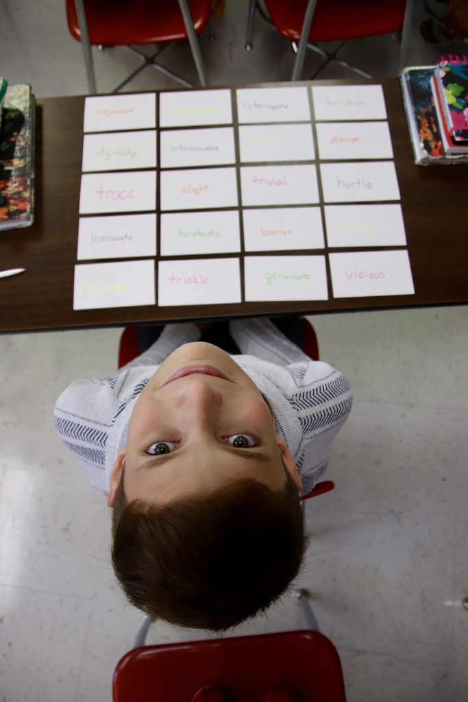 7th grader showing off his creativity with his vocabulary notecards