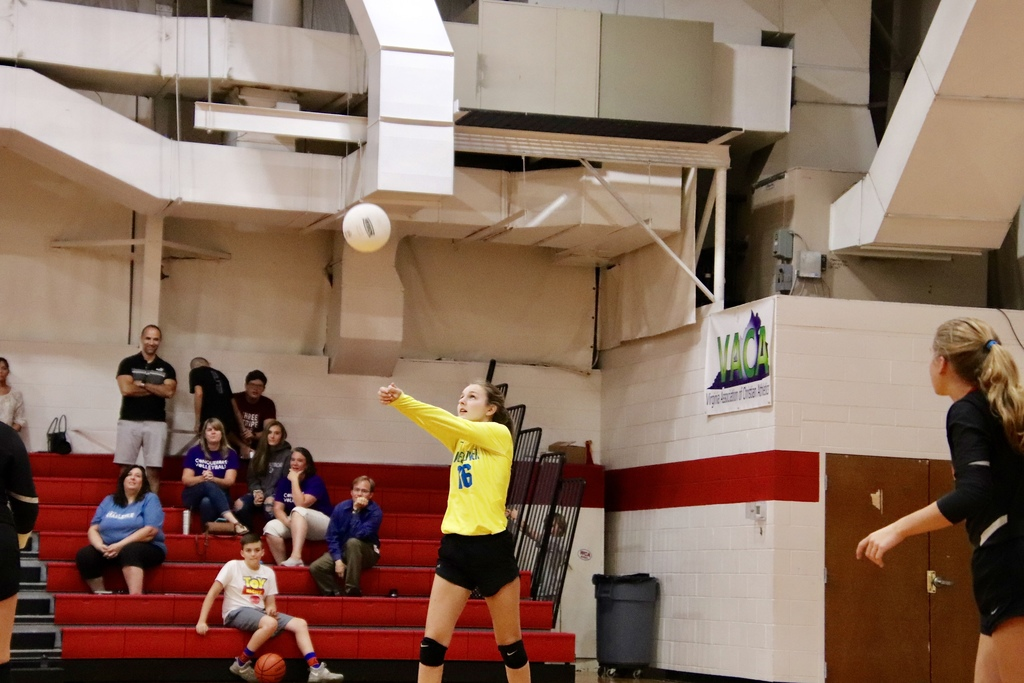 JV Girls Volleyball player serving