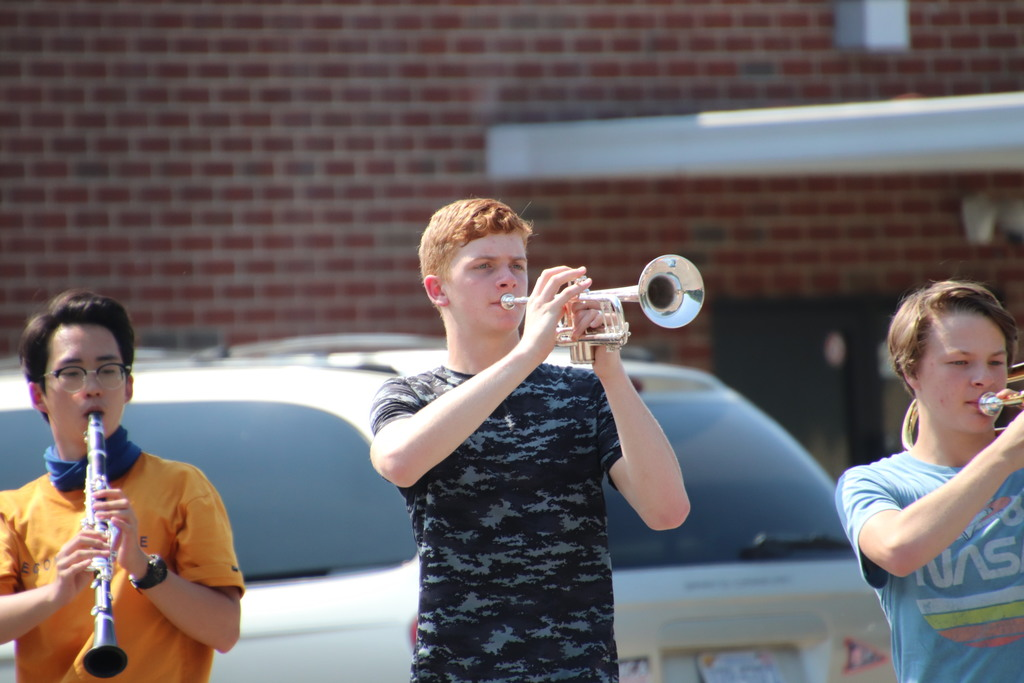 band member blowing trumpet and practicing for upcoming field show