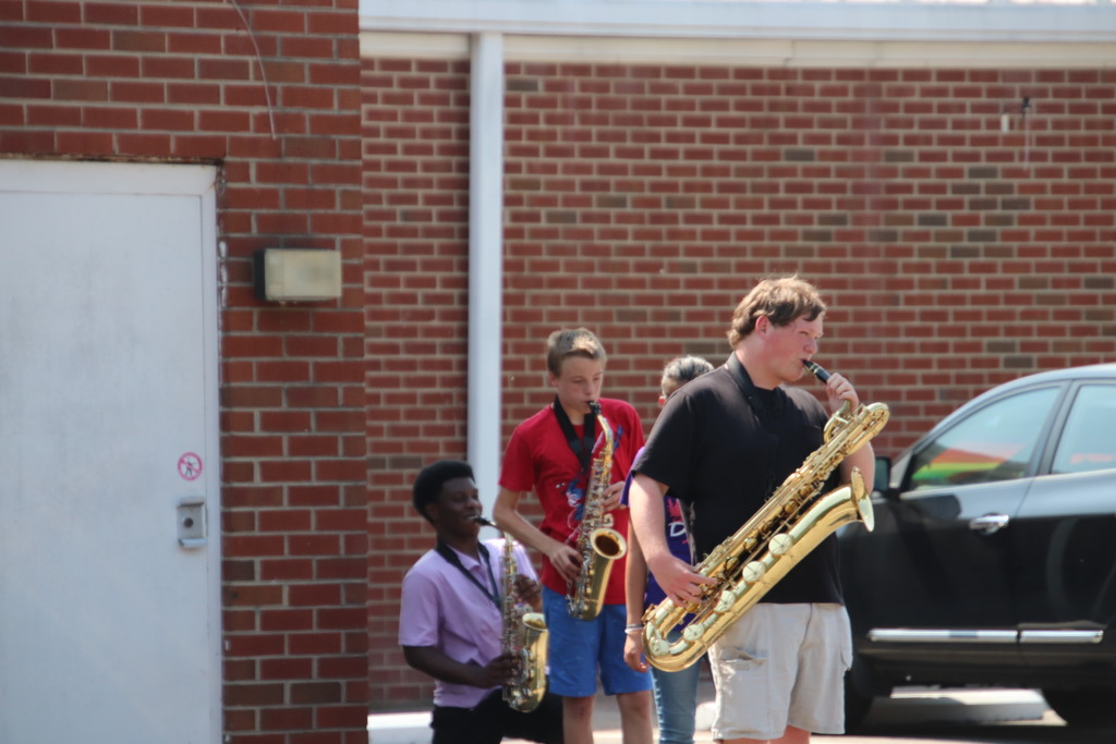band members practicing saxophone outside for the upcoming field show