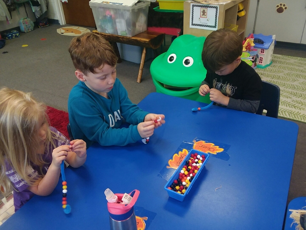 Stringing our beads to make snakes