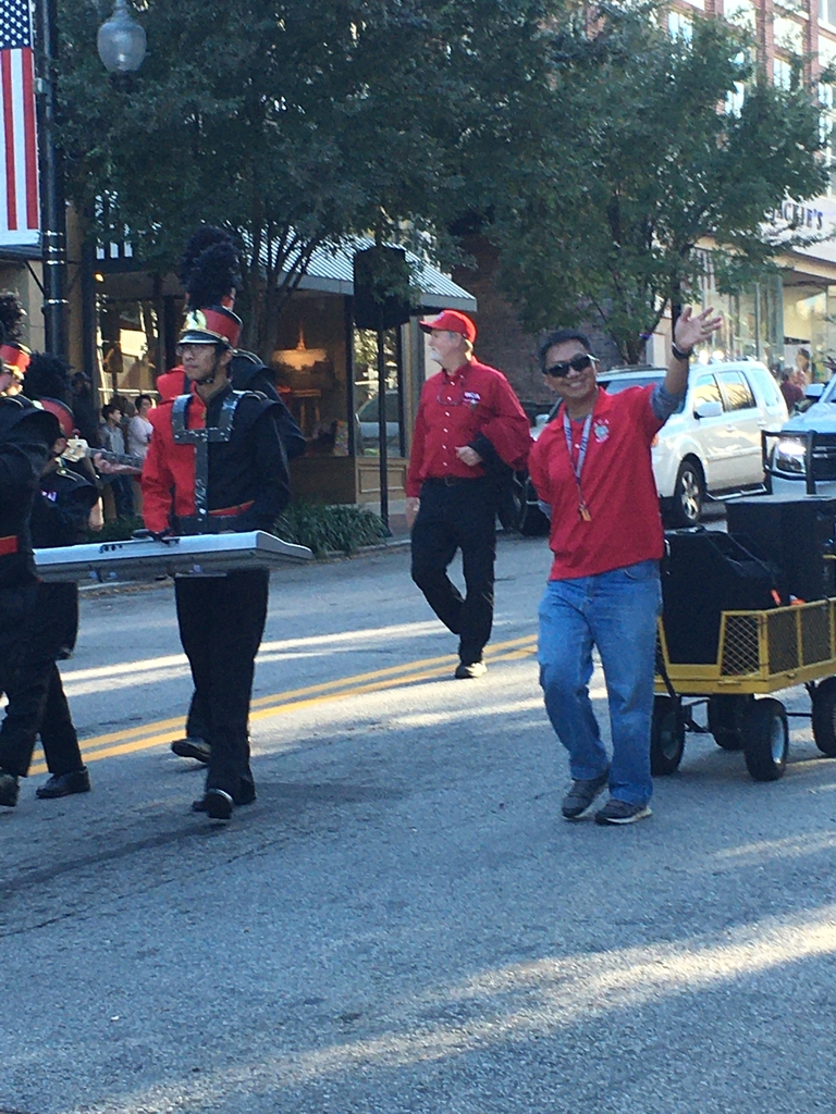 Papa John walking with the band in the Veterans Day Parade.
