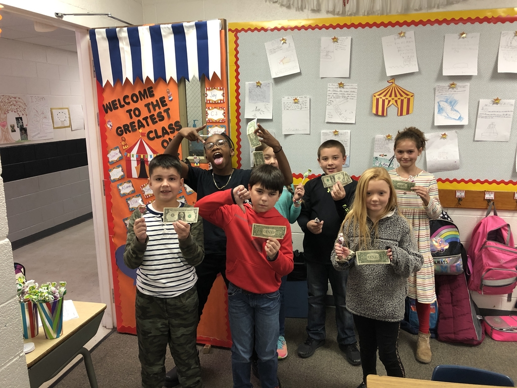 4th graders with their winnings