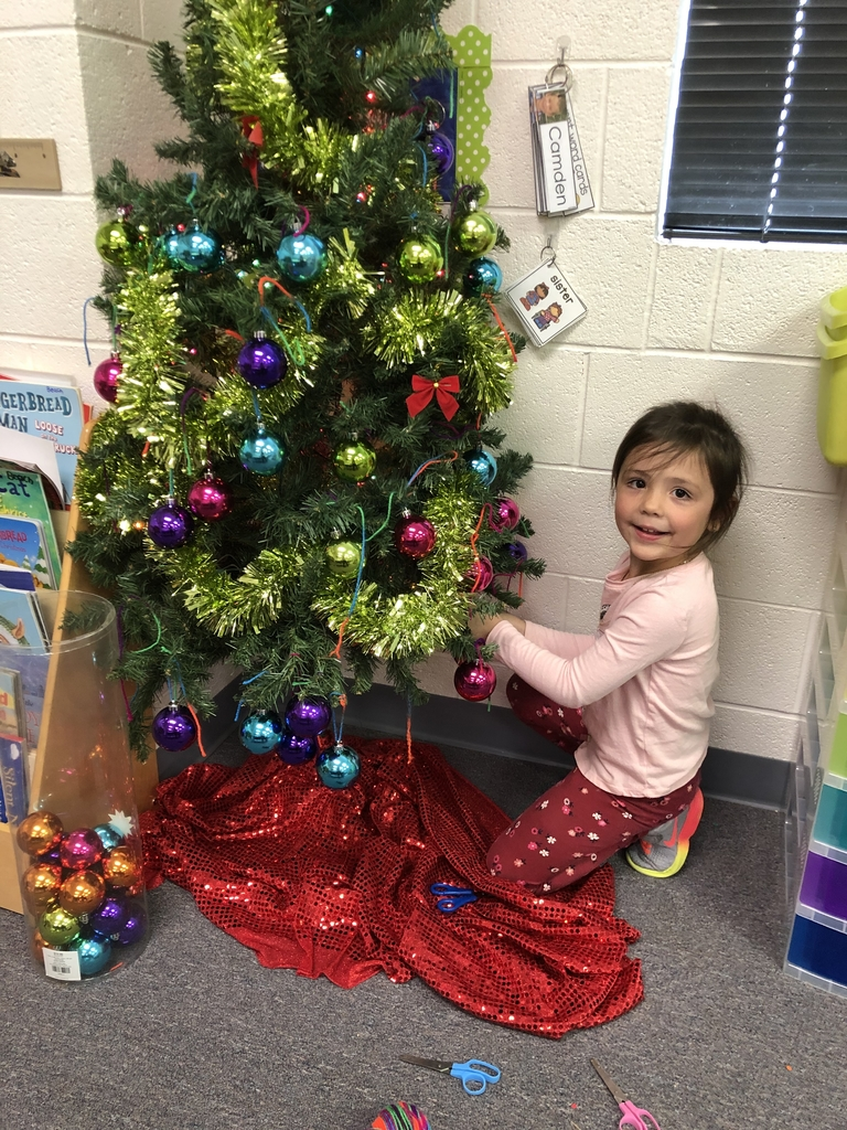 Decorating the classroom Christmas tree!