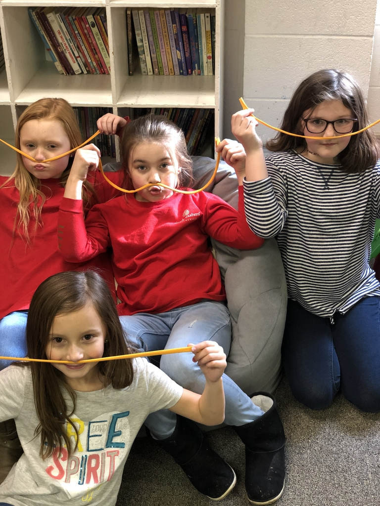 4th grade girls having fun with mustaches!