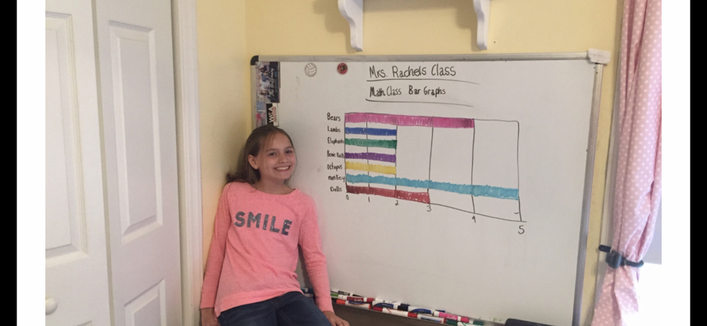 Fourth grader pictured with her Bar Graph!